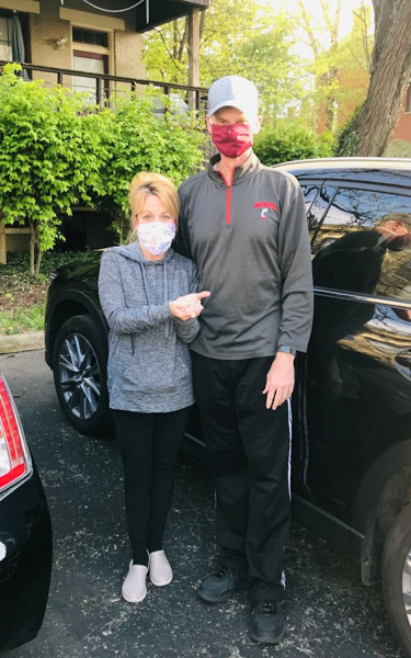 Ken Schlachter and wife in masks - COVID-19
